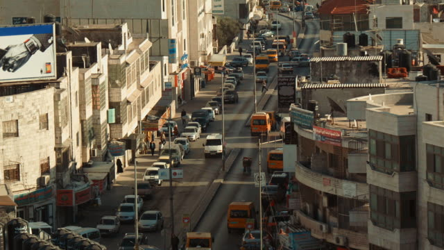 street in ramallah with traffic seen from above - palestinian territories stock videos and b-roll footage