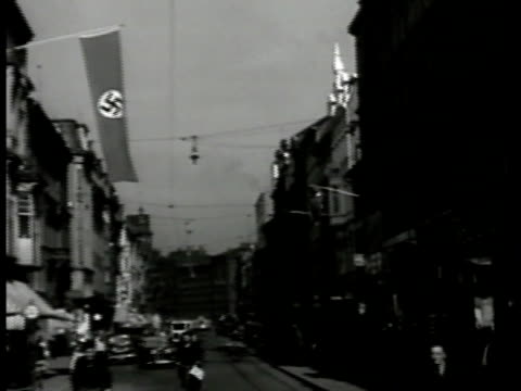 germany street in saarbrucken w/ hanging nazi banner ext restaurant w/ nazi sign german poster on building official german flags on building one w/... - 1935 stock videos & royalty-free footage