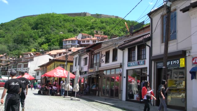 a street in the old town of prizren with the fortress of prizren, kosovo - serbia stock videos & royalty-free footage