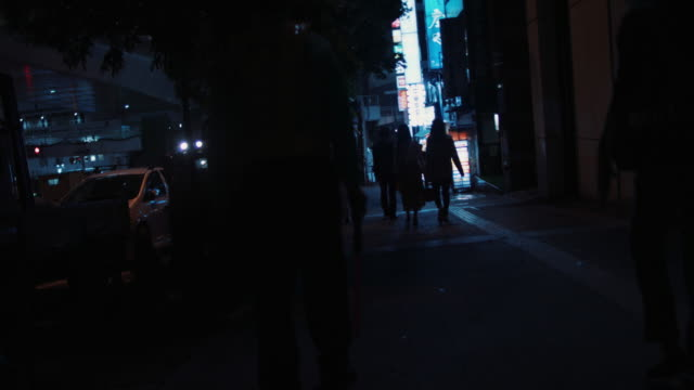 street in tokyo with incidental people - street light stock videos & royalty-free footage