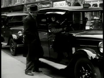 street intersection english pedestrians crossing light. dramatization: detective talking to cab driver. detective & cab driving walking entering... - 1949 stock videos & royalty-free footage