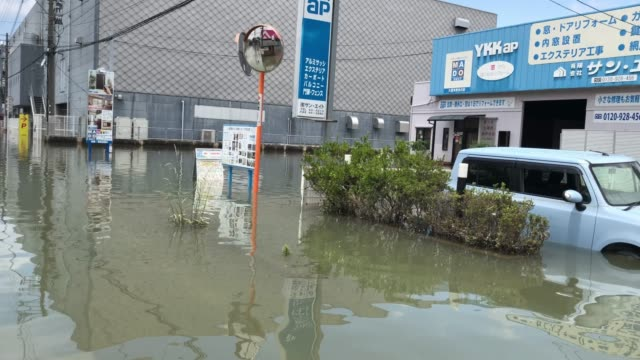street is covered in floodwater following torrential rain, on july 8, 2020 in kurume, japan. around 60 people are believed to be dead and many... - fukuoka prefecture stock videos & royalty-free footage