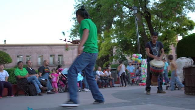 street juggler & drummers perform in park - street performer stock videos and b-roll footage