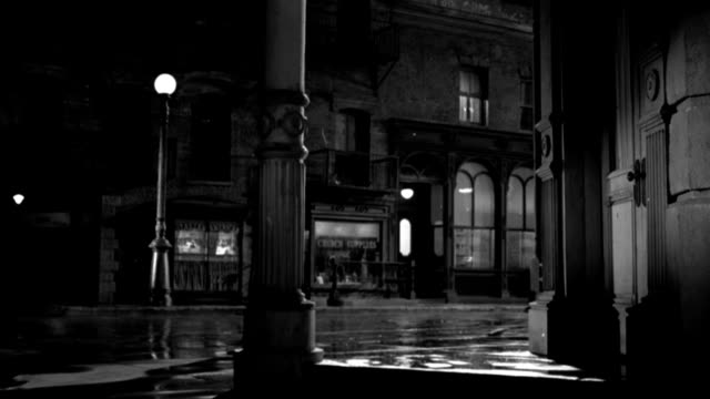 a street lamp glows in a deserted city street. - 1958 stock videos & royalty-free footage