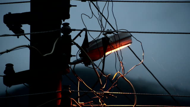 street lamp under rain - power cable stock videos & royalty-free footage