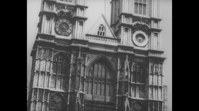 street level shot of front of westminster abbey tilt up twin towers / overhead shot of front of abbey tilt up twin towers / note exact year not known - westminster abbey stock videos & royalty-free footage