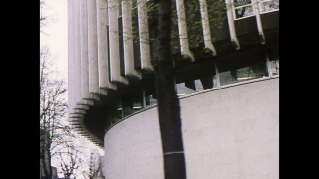 zu street level view of modern style buildings / uk - curtain wall facade stock videos and b-roll footage