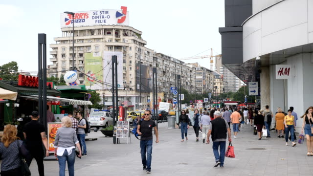street life with traffic, pedestrians, city life / bucharest - vlad the impaler stock videos & royalty-free footage
