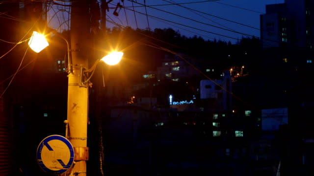 street light and telephone pole in alley - telephone line stock videos and b-roll footage