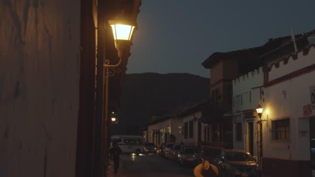 street lights illuminating a narrow street in san cristobal de las casas, chiapas, mexico - electric lamp stock videos & royalty-free footage