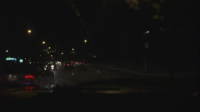 Street lights line a busy highway.