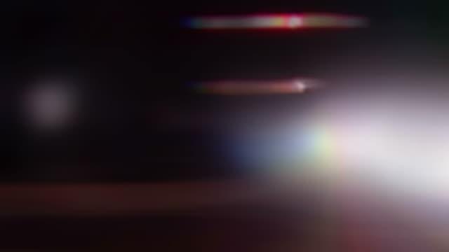 Street lights streak by (Loop).