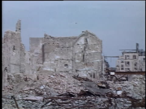 street lined with ruins of buildings destroyed by bombing / wiesbaden germany - ruine stock-videos und b-roll-filmmaterial