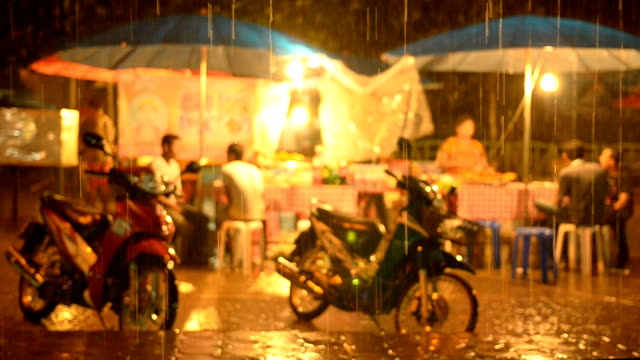 street market at night in rainy seasons - wet stock videos & royalty-free footage