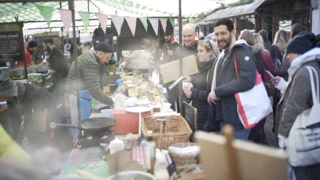 street market making hot fresh food. - east london stock videos and b-roll footage