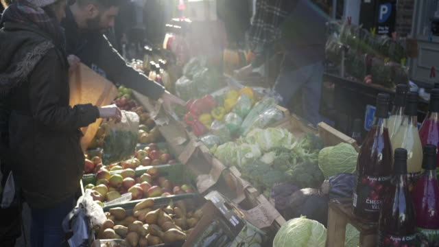 street market veg stall. - market stall stock videos & royalty-free footage