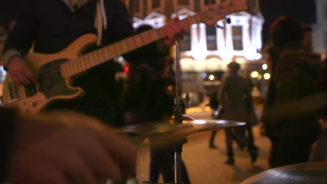 street music baskers at night - street performer stock videos and b-roll footage