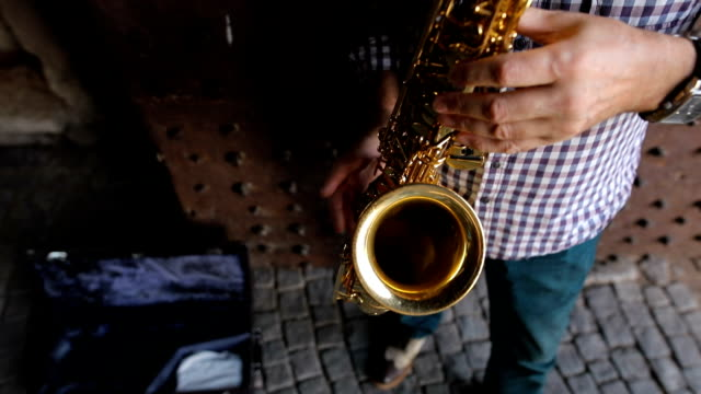 street musician playing the saxophone - musician stock videos & royalty-free footage