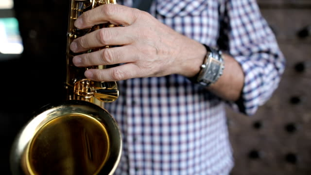 street musician playing the saxophone - saxophone stock videos and b-roll footage