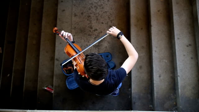 street musician playing violin - musician stock videos & royalty-free footage