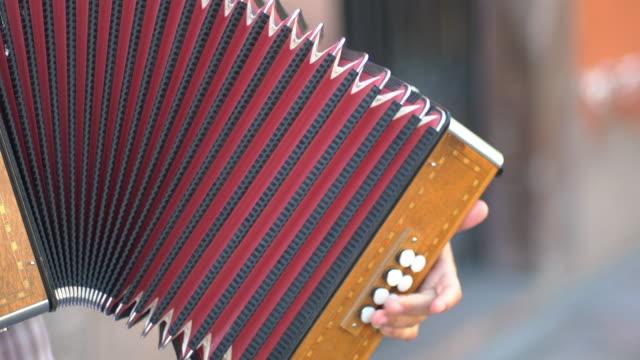 vídeos y material grabado en eventos de stock de street musician's accordion, cu - acordeonista