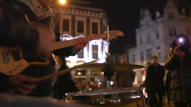 street musicians are playing at night - guitar stock videos & royalty-free footage