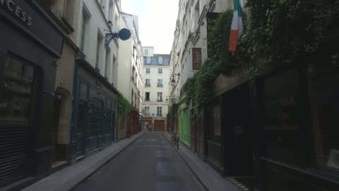 street of paris during confinement. under france's coronavirus pandemic lockdown. - france stock videos & royalty-free footage