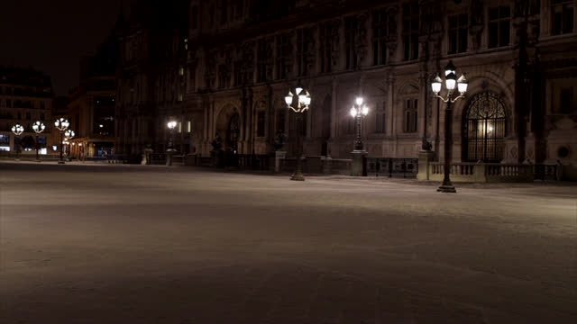 street of paris , during curfew, after light snowfall overnight on february 10, 2021 in paris, france. the cold snap that hit the north of france... - electric lamp stock videos & royalty-free footage