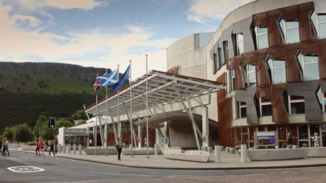 street outside scottish parliament building - scottish flag stock videos & royalty-free footage