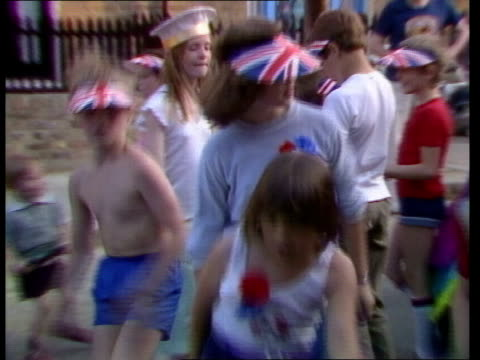 street parties royal wedding street parties england fulham ms flags across street pull back as children dance ms dancing in street more ditto brixton... - ブリックストン点の映像素材/bロール