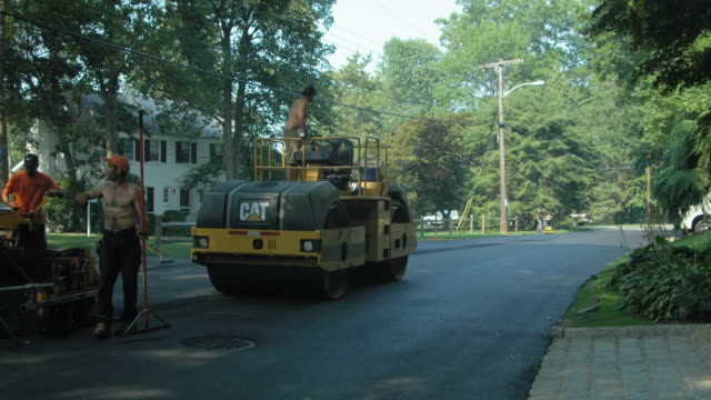 t/l ws pan street pavers repairing shore acres drive, mamaroneck, new york state, usa - dump truck stock videos and b-roll footage