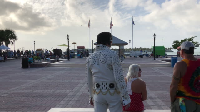 street performer elvis presley and vendors in mallory square key west - key west stock videos & royalty-free footage
