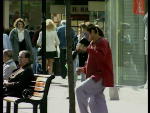 street performer in face paints juggles balls in pedestrian precinct nottingham; 10 apr 97 - 1997 stock videos and b-roll footage