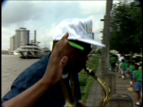 street performer playing alto sax on dock - woodwind instrument stock videos and b-roll footage