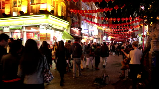 street performers in london chinatown night shot - street performer stock videos and b-roll footage