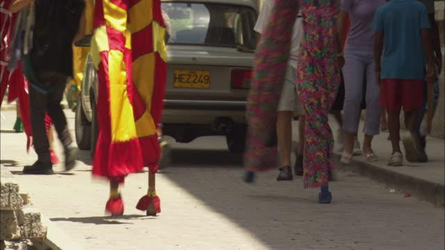 ms, tu, street performers on stilts walking down street, havana, cuba - stilts stock videos and b-roll footage