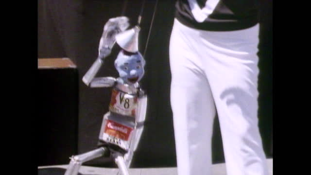 street performers work the crowd in new york block party; 1987 - puppet stock videos & royalty-free footage