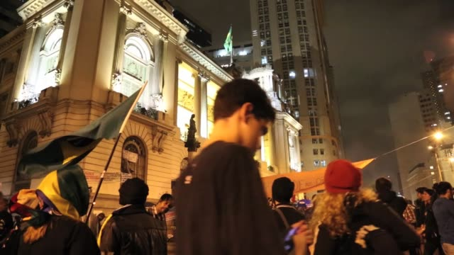 Street protest in Rio de Janeiro Brazil against corruption surrounding Olympics and World Cup turns violent when Black Bloc attacks banks government...
