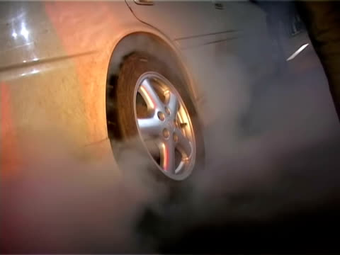 street racing. car burning tires.  auto sport - wheel stock videos and b-roll footage