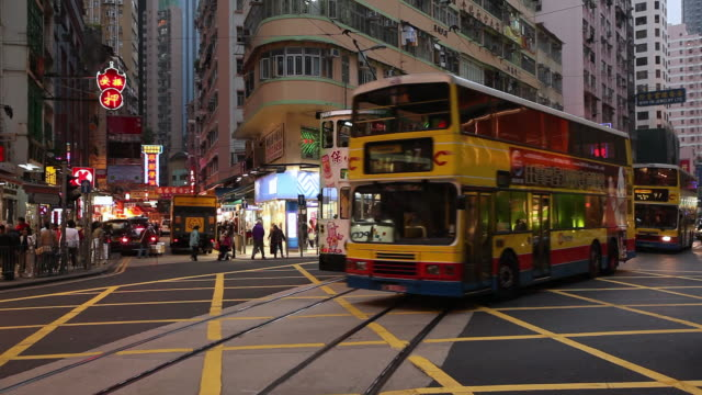 MS Street railcars, buses and cars moving on street / Hong Kong, China