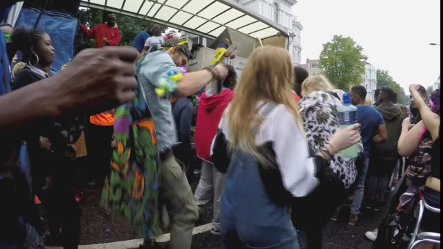 street revelers and parade goers at the annual notting hill carnival, london, 2015. - お祭り好き点の映像素材/bロール