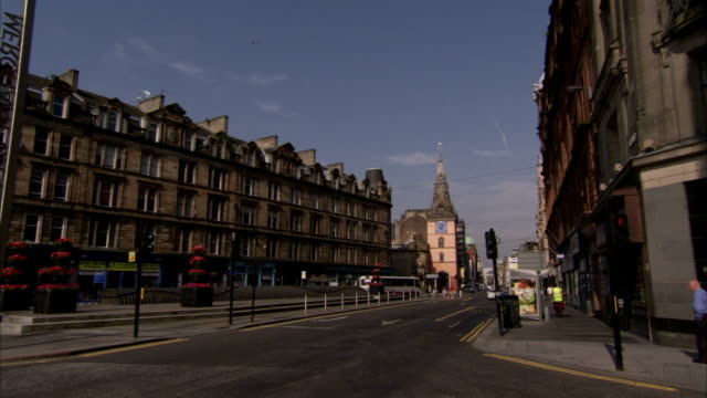 A street runs past the Victorian House in Glasgow Scotland. Available in HD.