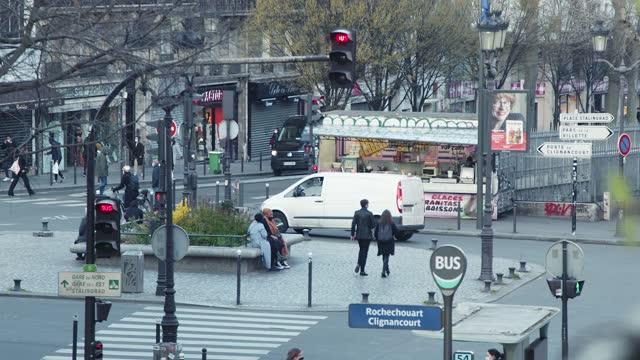 street scene at boulevard marguerite de rochechouart in paris france - boulevard stock videos & royalty-free footage