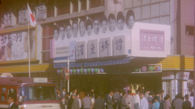 street scene at downtown on november 01 1964 in tokyo japan - poster stock videos & royalty-free footage
