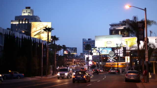 ws street scene at dusk / hollywood, los angeles, california, usa - sunset boulevard stock-videos und b-roll-filmmaterial