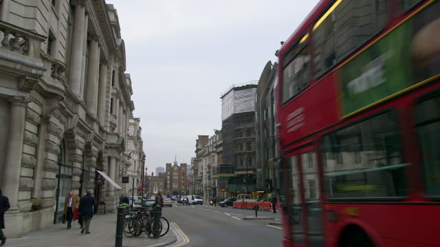 ws street scene at westminster / london, england, united kingdom - autobus a due piani video stock e b–roll