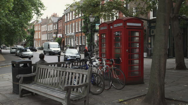 WS Street scene, bench, telephone booths and bicycles in foreground / Richmond, London, United Kingdom