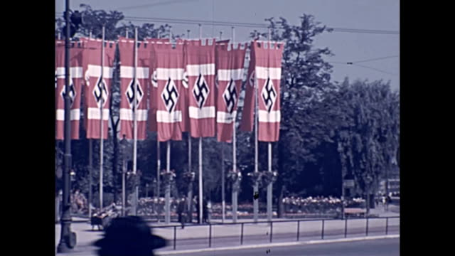 street scene captured by an amateur in germany weeks before the outbreak of ww2 shows nazi flags hanging in full color / people go about their... - world war ii stock videos & royalty-free footage