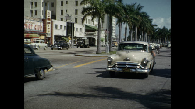 stockvideo's en b-roll-footage met 1954 montage street scene, fort myers, florida, usa - fort myers