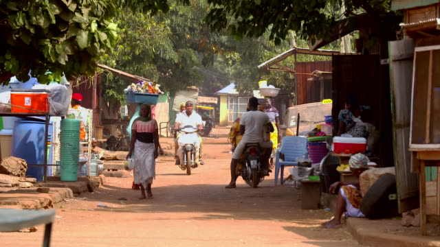 street scene in african village - ghana stock videos & royalty-free footage